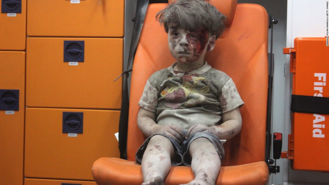 "<strong>2016: Aleppo, Syria</strong> -- Five-year-old Omran Daqneesh waits shell-shocked in the back of an ambulance. He and other members of his family were injured when airstrikes ripped through his neighborhood in August. The photo <a href=""http://www.cnn.com/2016/08/17/world/syria-little-boy-airstrike-victim/"" target=""_blank"">inspired international grief</a> and put a face on Syria's ongoing civil war."