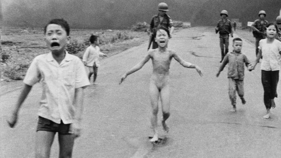 1972: Trang Bang, South Vietnam -- Nine-year-old Kim Phuc wails in agony as she and her fellow villagers flee a napalm attack. This unflinching look into the horrors of the Vietnam War earned a Pulitzer Prize. Phuc survived, and eventually started her own foundation to aid child victims of war.