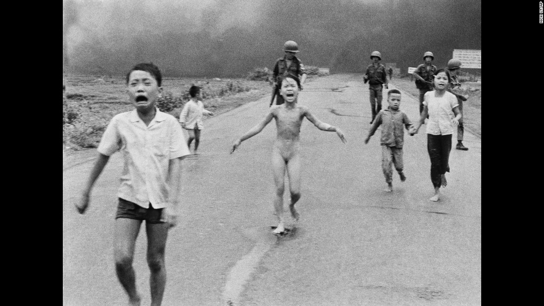 "<strong>1972: Trang Bang, South Vietnam </strong>-- Nine-year-old Kim Phuc wails in agony as she and her fellow villagers flee a napalm attack. This unflinching look into the horrors of the Vietnam War earned a Pulitzer Prize. Phuc survived, and <a href=""http://www.cnn.com/2015/06/22/world/kim-phuc-where-is-she-now/"" target=""_blank"">eventually started her own foundation</a> to aid child victims of war."