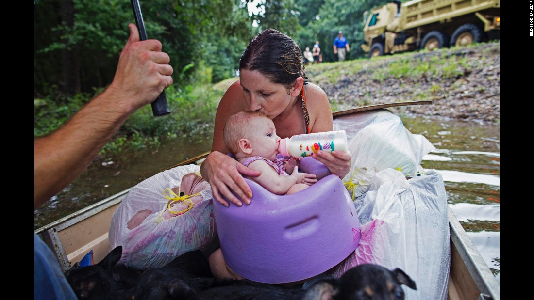 "Danielle Blount and her 3-month-old baby, Ember, wait to be rescued by the Louisiana Army National Guard near Walker, Louisiana, on Monday, August 15. More than 30,000 people have been rescued in southern Louisiana after <a href=""http://www.cnn.com/2016/08/13/us/gallery/louisiana-flooding/index.html"" target=""_blank"">heavy rains caused flooding</a> over the weekend. It is the worst natural disaster to strike the United States since Hurricane Sandy four years ago, the Red Cross said."