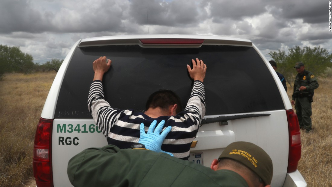Detained immigrants are searched after being captured by Border Patrol agents in Roma, Texas, on Tuesday, August 16.