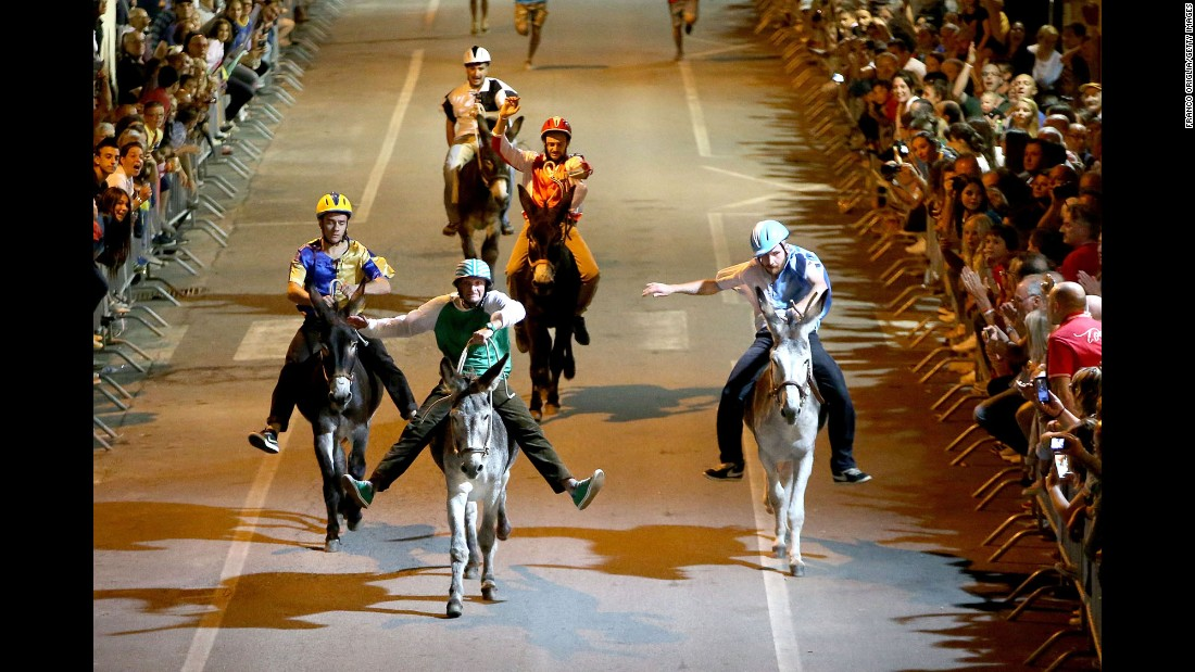Riders compete in the 86th Palio dei Ciuchi (Donkey Race) in Roccatederighi, Italy, on Sunday, August 14. At one time the donkey was an indispensable part of life for the citizens of this town, and they celebrate the animal in a race held every August.