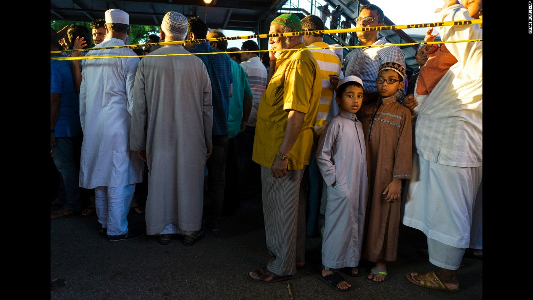 "People gather for a demonstration in the Queens borough of New York on Saturday, August 13. Imam Maulama Akonjee, 55, and his assistant, 64-year-old Thara Uddin, <a href=""http://www.cnn.com/2016/08/15/us/new-york-imam-shooting/"" target=""_blank"">were gunned down</a> after prayers at a nearby mosque, police said. A suspect has been charged with murder."