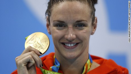 TOPSHOT - Hungary's Katinka Hosszu poses with her gold medal on the podium after she won the Women's 200m Individual Medley Final during the swimming event at the Rio 2016 Olympic Games at the Olympic Aquatics Stadium in Rio de Janeiro on August 9, 2016.   / AFP / Odd Andersen        (Photo credit should read ODD ANDERSEN/AFP/Getty Images)
