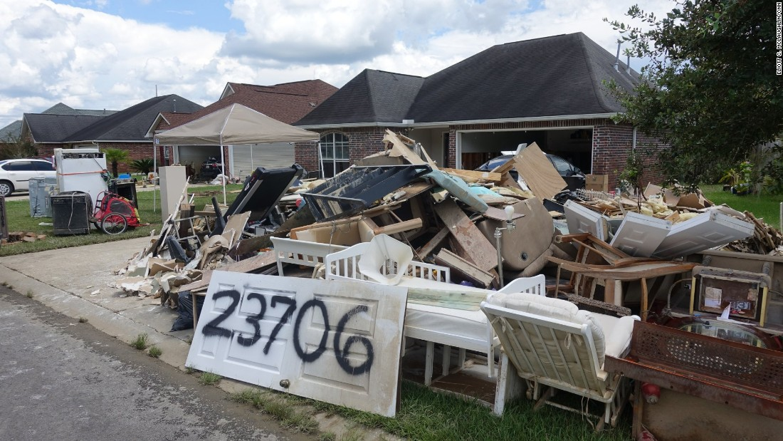 Not only did some residents lose most, if not all, of their belongings in the South Point subdivision of Denham Springs, Louisiana, but because the floodwaters washed away house numbers and mailboxes, people spray-painted their addresses on doors so police and insurance adjusters can find their homes.