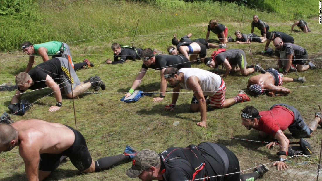 The barbed wire crawl is a signature Spartan obstacle.