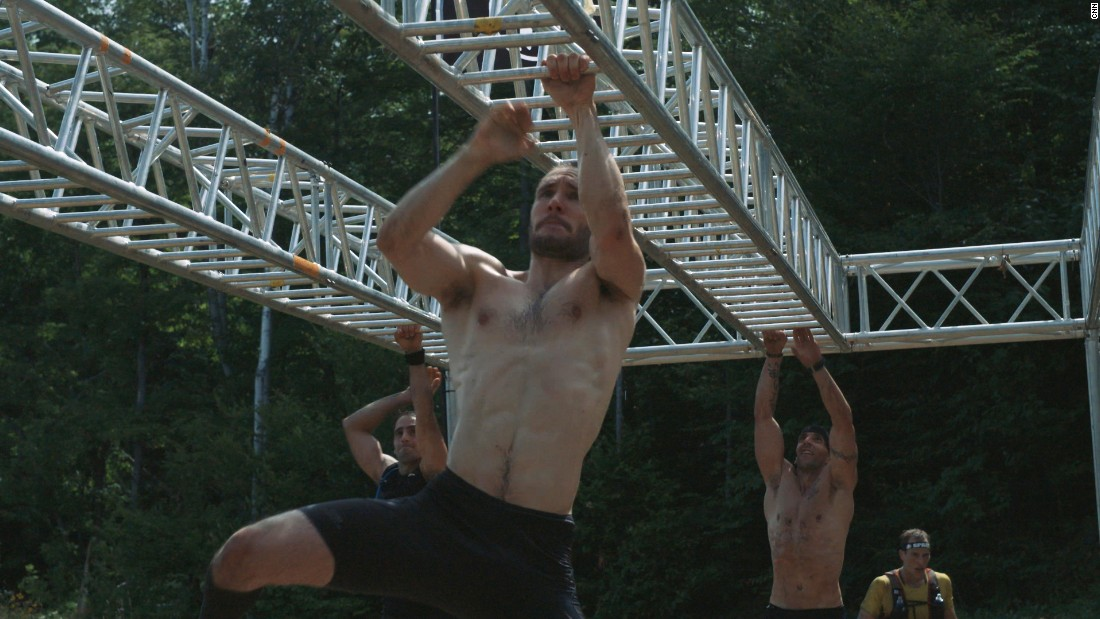 At the end of the monkey bars, the competitors must ring a cow bell before jumping down.