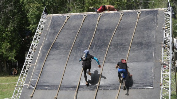 The final obstacle on the course is the Slip Wall. Some runners have enough speed to reach the top without using a rope.