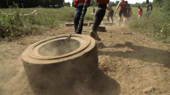 Participants haul tractor tires.
