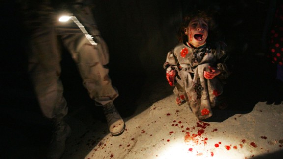2005: Tal Afar, Iraq -- In a time when truly resonant war photos were hard to come by due to the dangerous climate in Iraq, a photographer captured a truly wrenching moment. The girl is Samar Hassan, screaming and spattered with blood after her parents were mistakenly killed and her brother was wounded by U.S. troops. The image was widely used to represent the true civilian cost of international conflict.