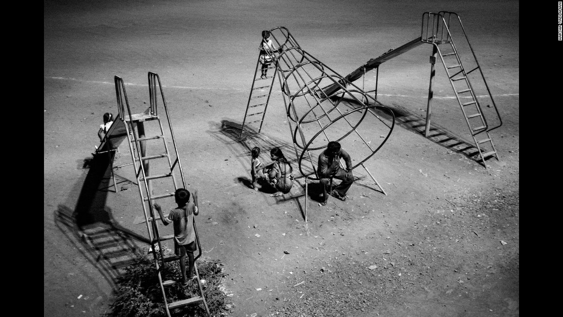 The lack of work in villages during the summer months has forced many farmer families to migrate to cities such as Mumbai, Pune and Hyderabad. Here, a migrant family from Nanded, India, spends an evening at a Mumbai playground, just outside an open ground where a number of families have set up camp.