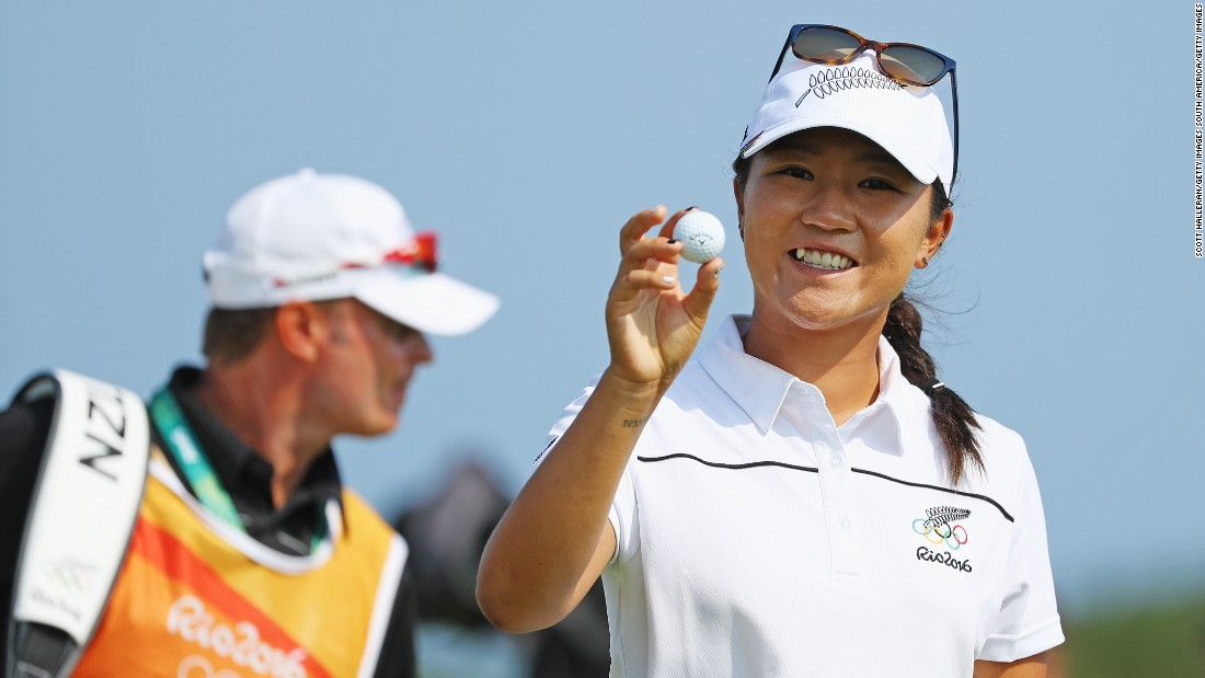 Focus then switched to golf's first inclusion at the Olympics since 1906. Ko poses with the ball she used to make a hole-in-one at the Rio 2016 - her first ever in professional competition.
