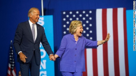 Democratic Presidential candidate Hillary Clinton and US Vice President Joe Biden acknowledge the crowd at Riverfront Sports athletic facility on August 15, 2016 in Scranton, Pennsylvania.
