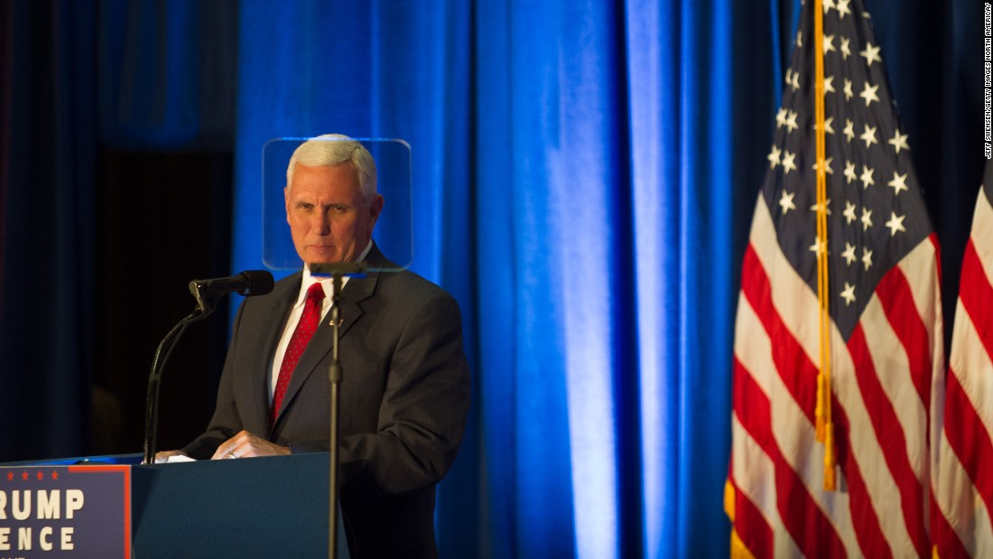 Pence introduces his running mate, Trump, at a campaign event at Youngstown  State University