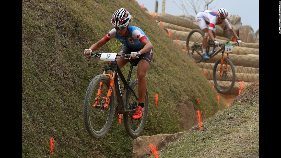 Emily Batty of Canada, left, and Katerina Nash of the Czech Republic compete in the cross-country mountain bike race.