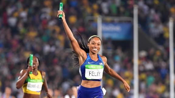 American runner Allyson Felix celebrates as she crosses the finish line to win the women