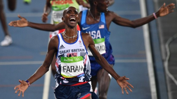 Mo Farah celebrates after crossing the finish line to win the men