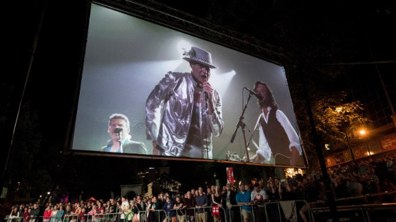 The Tragically Hip's frontman Gord Downie is displayed on a screen during a public viewing of the band's final concert in Halifax, Nova Scotia, Saturday, Aug. 20, 2016. (Darren Calabrese/The Canadian Press via AP)