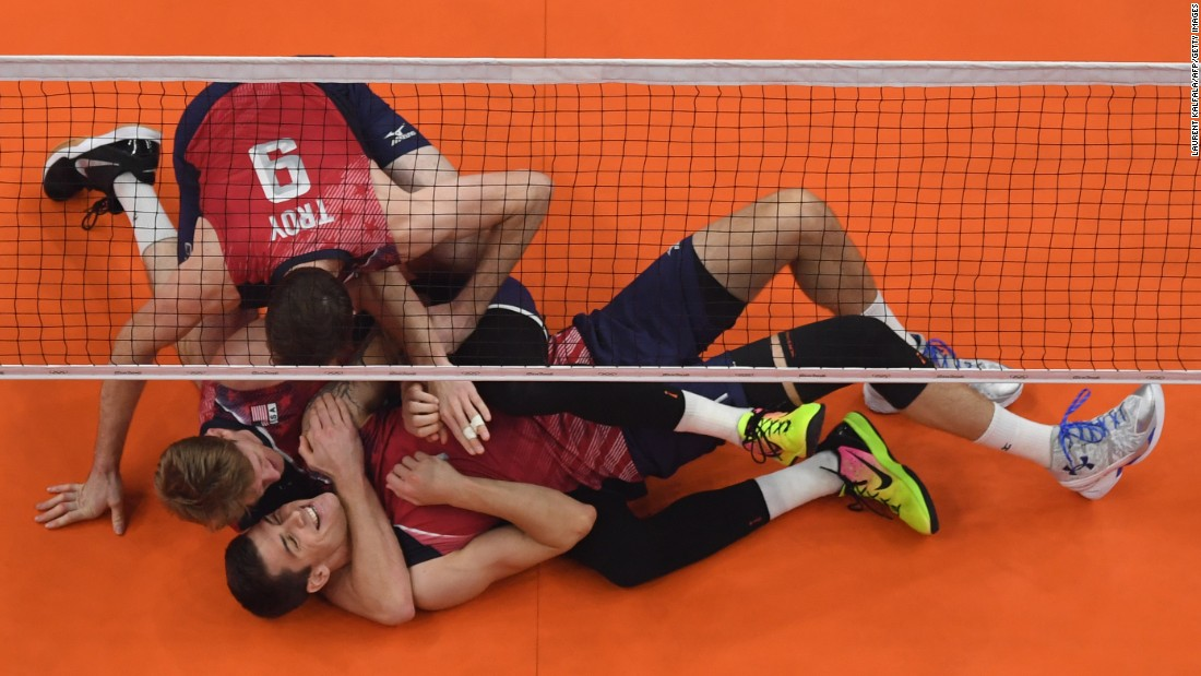 U.S. volleyball players celebrate after winning bronze in a game against Russia.
