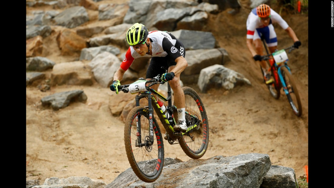 Swiss cyclist Nino Schurter, left, and Jaroslav Kulhavy of the Czech Republic take part in the cross-country mountain bike race. Schurter and Kulhavy earned gold and silver, respectively, while Spain's Carlos Coloma Nicolas finished with the bronze.