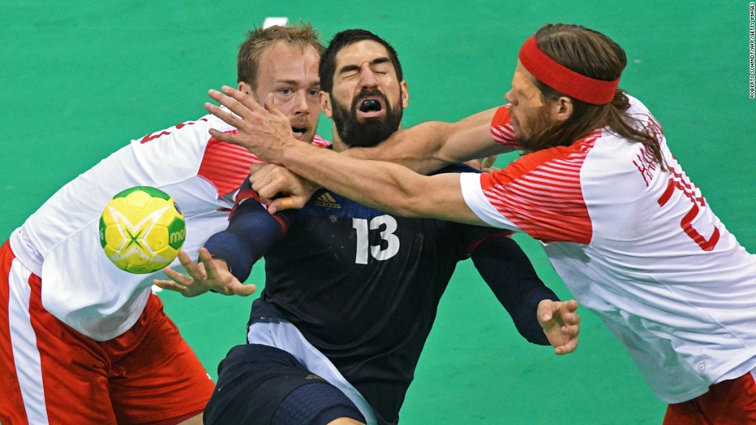 France's Nikola Karabatic, center, vies with Denmark's Henrik Toft Hansen and Mikkel Hansen during their gold medal handball match. The Danish came out on top, defeating the French 28-26.