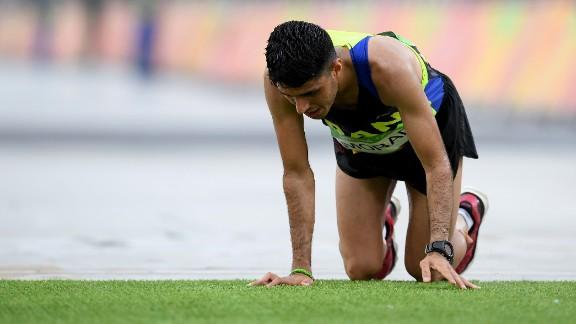 Iran's Mohammad Jafar Moradi struggles to finish the marathon.