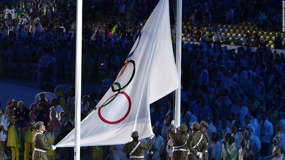 The Olympic flag is lowered.