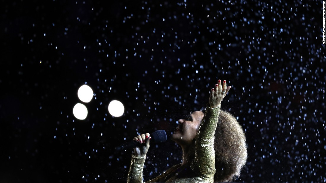 Singer Mariene de Castro performs in front of the Olympic Cauldron before the flame was extinguished.