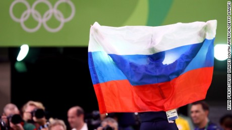 A Russian supporter holds aloft a flag to support the team members competing in Rio.