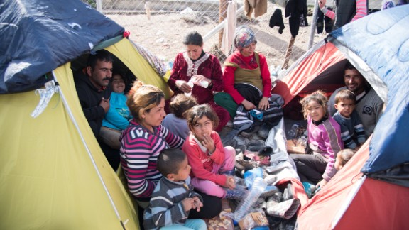 Families shelter in tents at a camp in Greece.