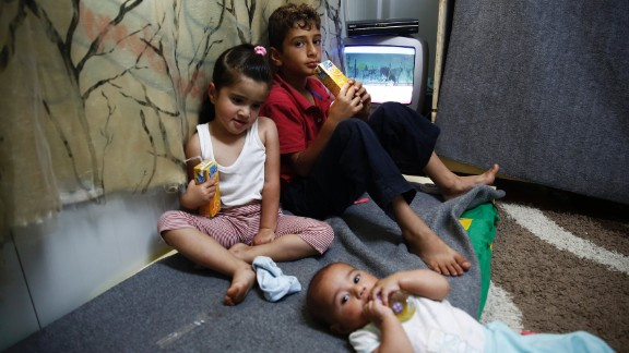 Tuba (pictured far right with siblings Abdulah and Jehna) was just 20 days old when her family fled Syria in a boat to Greece.