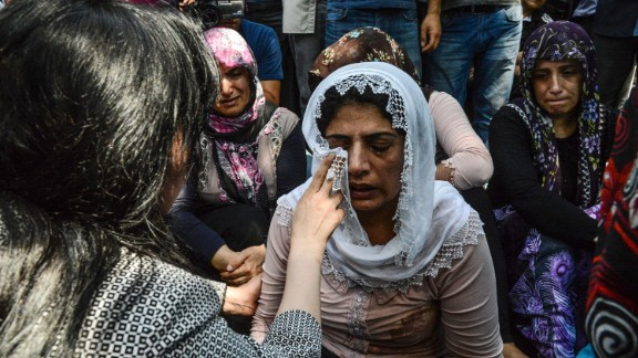 Mourners weep at a funeral Sunday for victims of the bombing in the southern Turkish city.