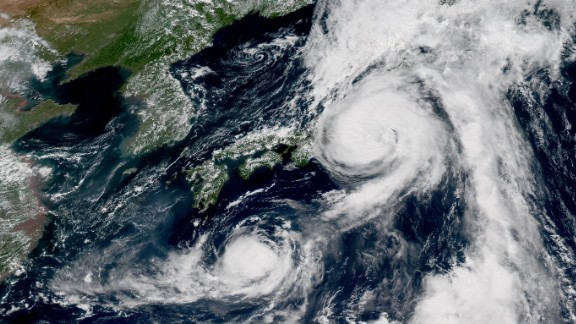 Typhoons Mindulle and Lionrock sit off the Japanese coast on Monday