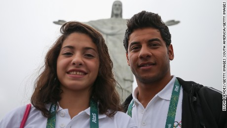 Olympic refugee team swimmers Yusra Mardini and Rami Anis pose for a photo in front of the Christ the Redeemer statue on in Rio de Janeiro, Brazil.