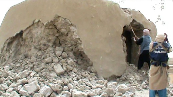 A still from a video shows Islamist militants destroying an ancient shrine in Timbuktu on July 1, 2012. Islamist rebels in northern Mali smashed four more tombs of ancient Muslim saints in Timbuktu on July 1 as the International Criminal Court warned their campaign of destruction was a war crime.  The hardline Islamists who seized control of Timbuktu along with the rest of northern Mali three months ago, consider the shrines to be idolatrous and have wrecked seven tombs in two days.    AFP PHOTO / AFP / STR        (Photo credit should read STR/AFP/Getty Images)