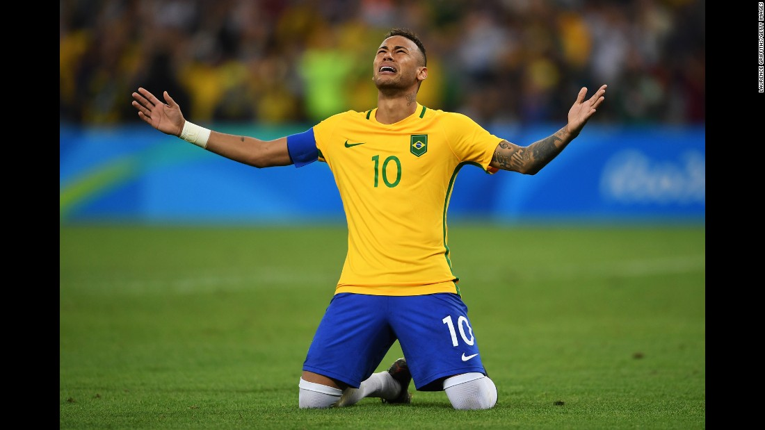 "Brazilian soccer star Neymar celebrates after scoring the winning penalty in the shootout against Germany on Saturday, August 20. It was Brazil's <a href=""http://www.cnn.com/2016/08/20/football/brazil-germany-neymar-goal-olympics-football/"" target=""_blank"">first gold medal in Olympic soccer.</a>"