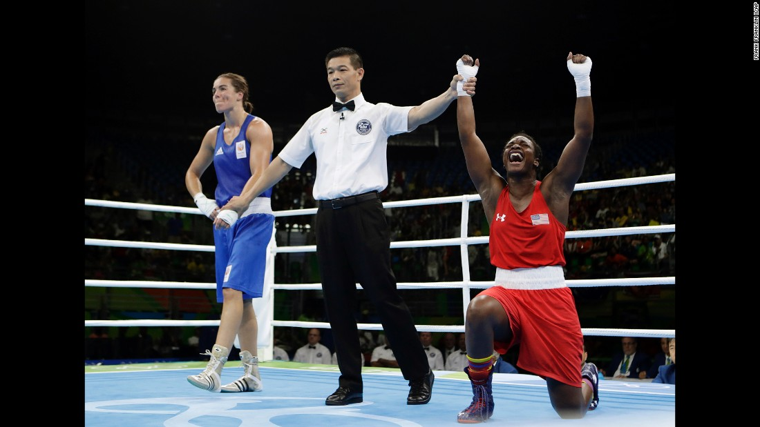 U.S. boxer Claressa Shields, right, reacts after winning gold in the middleweight final on Sunday, August 21. She also won gold in 2012.