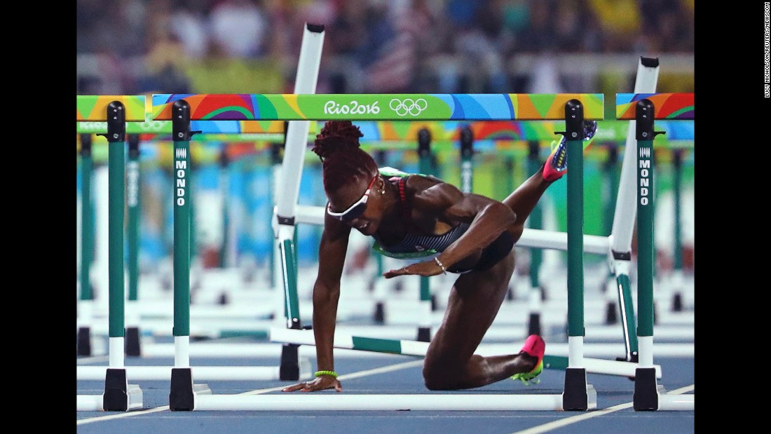 Canadian hurdler Nikkita Holder falls during the 100-meter semifinals on Wednesday, August 17.