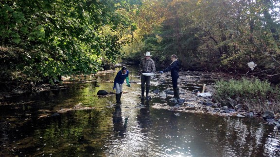 Researchers sample water from Gwynns Falls in Baltimore.