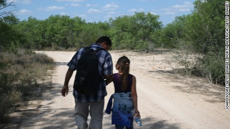 ROMA, TX - APRIL 14:  Ania, 9, from El Salvador walks with her father through the South Texas countryside after crossing the Rio Grande from Mexico into the United States to seek asylum on April 14, 2016 in Roma, Texas. Border security and immigration, both legal and otherwise, continue to be contentious national issues in the 2016 Presidential campaign.  (Photo by John Moore/Getty Images)