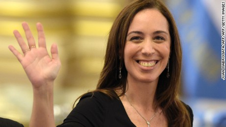 Buenos Aires province Governor Maria Eugenia Vidal waves during the inauguration ceremony of Argentine President-elect Mauricio Macri, at the Casa Rosada government palace in Buenos Aires on December 10, 2015. Macri's inauguration marks the start of a new era for Argentina: a tilt to the right after 12 years under Kirchner and her late husband Nestor, the left-wing power couple that led the country back to stability after an economic meltdown in 2001.At left Emilio Monzo, president of the lower chamber.  AFP PHOTO/JUAN MABROMATA / AFP / JUAN MABROMATA        (Photo credit should read JUAN MABROMATA/AFP/Getty Images)
