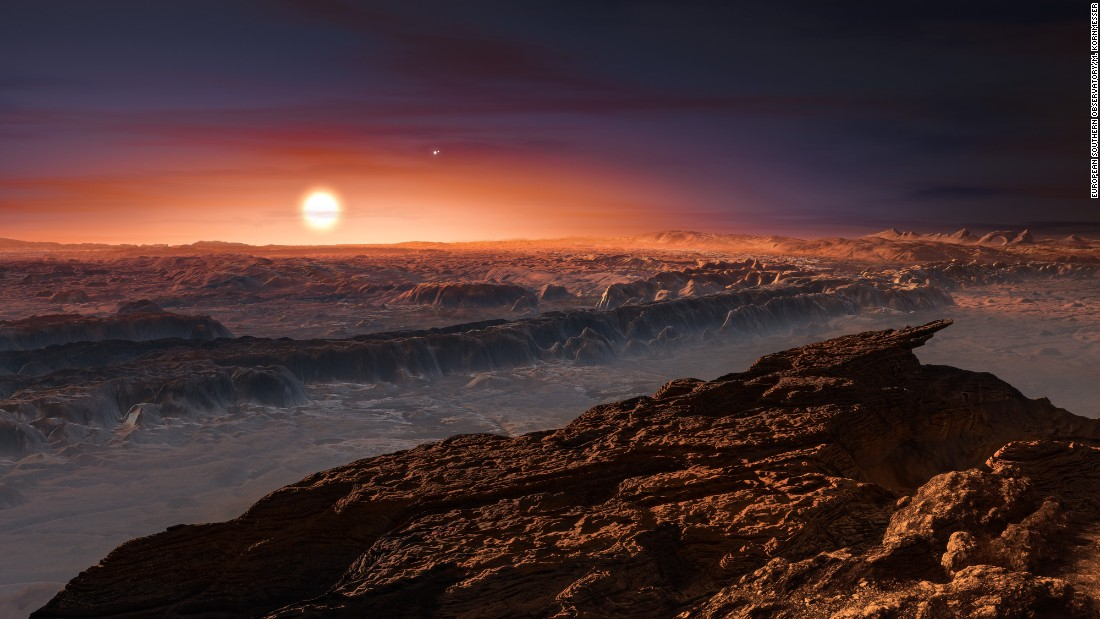 This artist's impression shows a view of the surface of the planet Proxima b orbiting the red dwarf star Proxima Centauri, the closest star to the Solar System. Proxima b is a little more massive than the Earth.