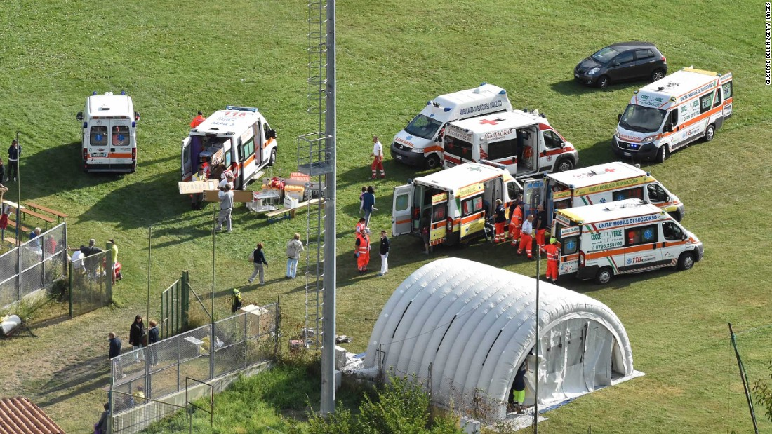 An emergency hospital camp is set up to treat earthquake victims in Arquata del Tronto.