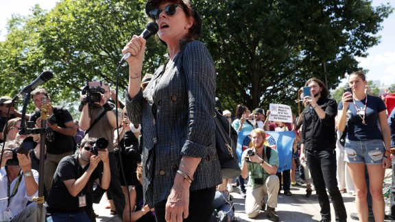 Susan Sarandon speaks as Shailene Woodley and comedian Lee Camp look on during a rally on Dakota Access Pipeline August 24, 2016 outside U.S. District Court in Washington, D.C.