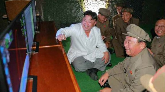 North Korean leader Kim Jong Un oversees the testing of a submarine launched ballistic missile test.