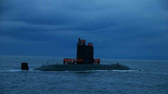 North Korean leader Kim Jong Un oversees the testing of a submarine launched ballistic missile test which he claimed as a success.