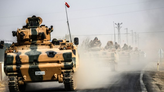 Turkish Army tanks drive to the Syrian border town of Jarabulus on August 25.