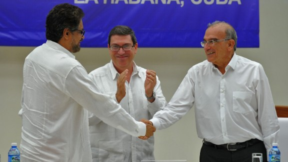 Sealed with a handshake: Colombian government representative Humberto de la Calle, right, and FARC commander Ivan Marquez greet each other after signing a peace deal in Havana.