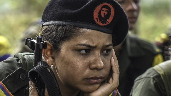 A FARC guerrilla listens during a class on the peace process and how life will be in the future.