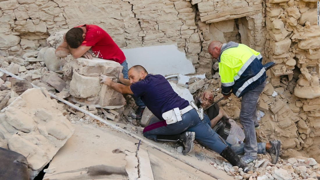"A man, in red, cries as his friend is pulled from the rubble after a 6.2-magnitude earthquake in Amatrice, Italy, on Wednesday, August 24. The earthquake -- which killed at least 250 people and injured more than 360 -- devastated towns across central Italy, leaving rescuers on a <a href=""http://www.cnn.com/2016/08/25/europe/italy-earthquake/"" target=""_blank"">desperate search for survivors</a>."